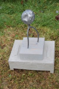'poor boy' (c), pitch fork , lead, wood17x19x8ins.